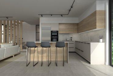 Cocina gris y roble abierta al salón